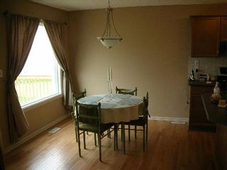 Photo 4: 1212 - 84 Street  SW: House for sale (Summerside)