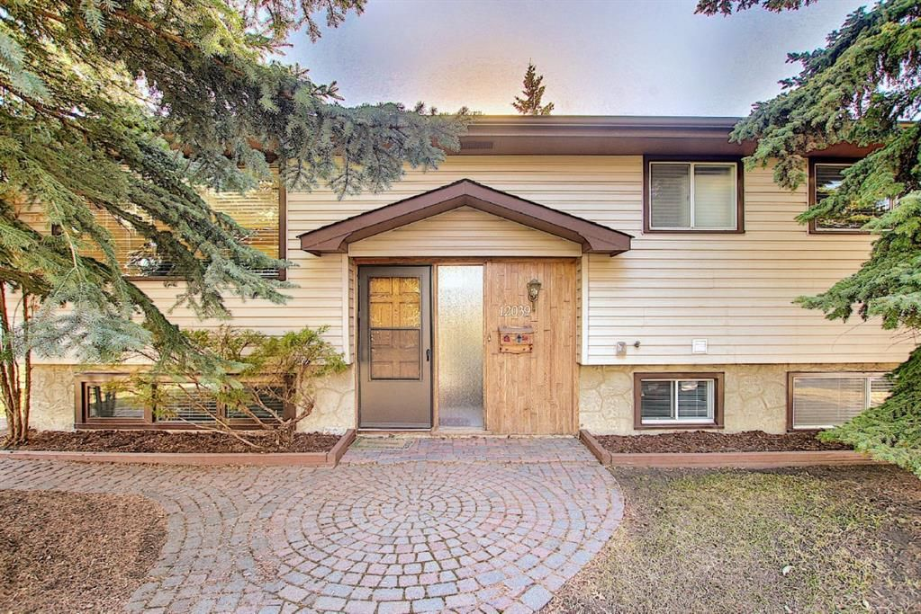 Main Photo: 12039 Candiac Road SW in Calgary: Canyon Meadows Detached for sale : MLS®# A1096218