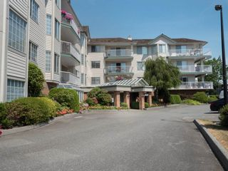 """Photo 1: 202 5363 206 Street in Langley: Langley City Condo for sale in """"Park Estates II"""" : MLS®# R2188125"""
