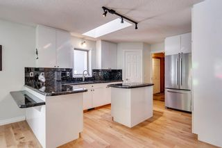 Photo 21: 222 SIGNATURE Way SW in Calgary: Signal Hill Detached for sale : MLS®# A1049165