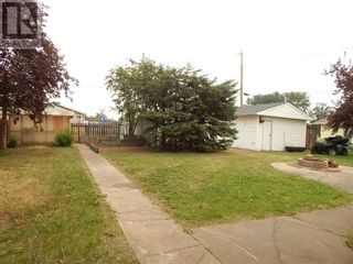 Photo 4: 10312 106 Avenue in High Level: House for sale : MLS®# A1130284