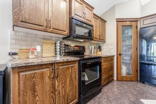 Photo 7: 6A Tusslewood Drive NW in Calgary: Tuscany Detached for sale : MLS®# A1115804