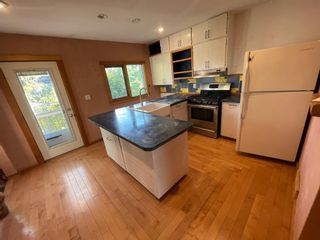 Photo 6: 509 55 Avenue SW in Calgary: Windsor Park Detached for sale : MLS®# A1148351