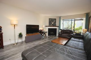 "Photo 3: 407 13501 96 Avenue in Surrey: Queen Mary Park Surrey Condo for sale in ""PARKSWOOD"" : MLS®# R2625516"