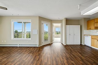 Photo 12: 301 305 1 Avenue NW: Airdrie Apartment for sale : MLS®# A1134588