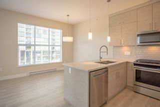 """Photo 7: 406 2120 GLADWIN Road in Abbotsford: Central Abbotsford Condo for sale in """"THE ONYX AT MAHOGANY"""" : MLS®# R2614339"""