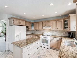 Photo 11: 54 Signature Close SW in Calgary: Signal Hill Detached for sale : MLS®# A1124573