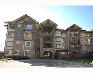"""Photo 1: 204 2958 WHISPER Way in Coquitlam: Westwood Plateau Condo for sale in """"SUMMERLIN"""" : MLS®# V786045"""