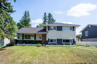 Photo 1: 2604 CHEROKEE Drive NW in Calgary: Charleswood Detached for sale : MLS®# A1019102