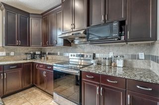 Photo 12: 1887 Panatella Boulevard NW in Calgary: Panorama Hills Detached for sale : MLS®# A1093201