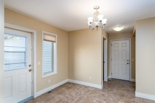Photo 11: 2 Mackenzie Way: Carstairs Detached for sale : MLS®# A1132226
