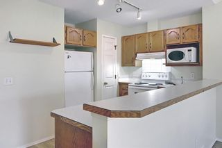Photo 8: 70 Tararidge Circle NE in Calgary: Taradale Row/Townhouse for sale : MLS®# A1131868