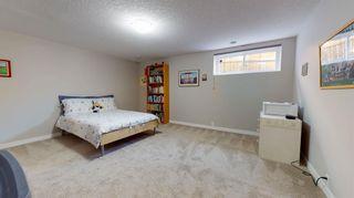 Photo 22: 210 Oakmoor Place SW in Calgary: Oakridge Detached for sale : MLS®# A1118445