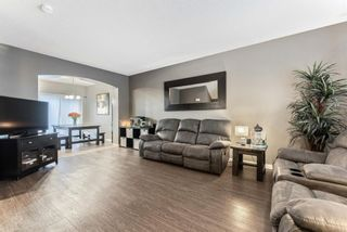 Photo 5: 130 Bishop Crescent NW: Langdon Detached for sale : MLS®# A1078277