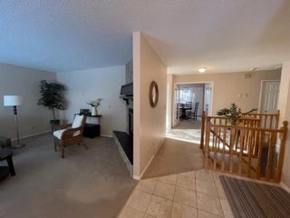 Photo 3: 15 Coach Side Terrace SW in Calgary: Coach Hill Row/Townhouse for sale : MLS®# A1071978