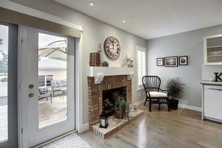 Photo 11: 231 COACHWAY Road SW in Calgary: Coach Hill Detached for sale : MLS®# C4305633