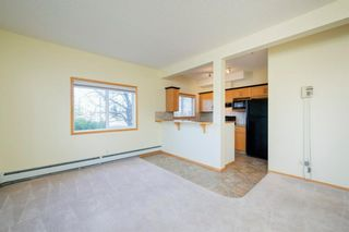 Photo 4: 101 72 Quigley Drive: Cochrane Apartment for sale : MLS®# A1091486