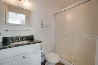 Photo 18: 18 Stradwick Rise SW in Calgary: Strathcona Park Semi Detached for sale : MLS®# A1125011