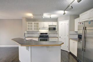 Photo 5: 11546 Tuscany Boulevard NW in Calgary: Tuscany Detached for sale : MLS®# A1136936