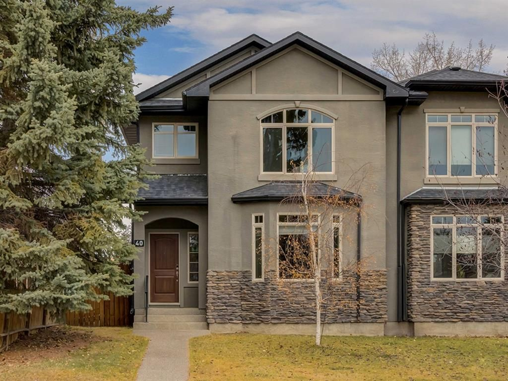 Main Photo: 40 ROSSDALE Road SW in Calgary: Rosscarrock Semi Detached for sale : MLS®# A1046518