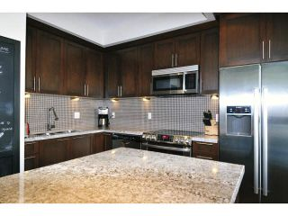 "Photo 2: 102 1480 SOUTHVIEW Street in Coquitlam: Burke Mountain Townhouse for sale in ""CEDAR CREEK NORTH"" : MLS®# V1088331"