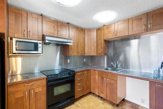 Photo 14: 128 Dovertree Place SE in Calgary: Dover Semi Detached for sale : MLS®# A1075565