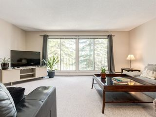 Photo 4: 516 3130 66 Avenue SW in Calgary: Lakeview Row/Townhouse for sale : MLS®# A1024120