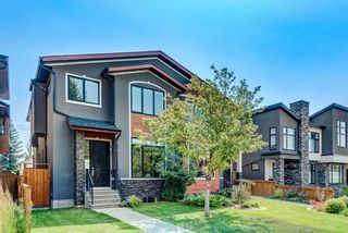 Main Photo: 913 21 Avenue NW in Calgary: Mount Pleasant Semi Detached for sale : MLS®# A1133082