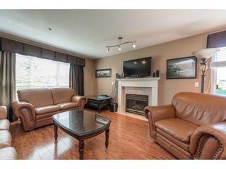 "Photo 2: 313 13860 70 Avenue in Surrey: East Newton Condo for sale in ""CHELSEA GARDENS"" : MLS®# R2175558"
