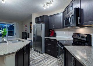 Photo 12: 40 EVANSRIDGE Court NW in Calgary: Evanston Row/Townhouse for sale : MLS®# A1095762