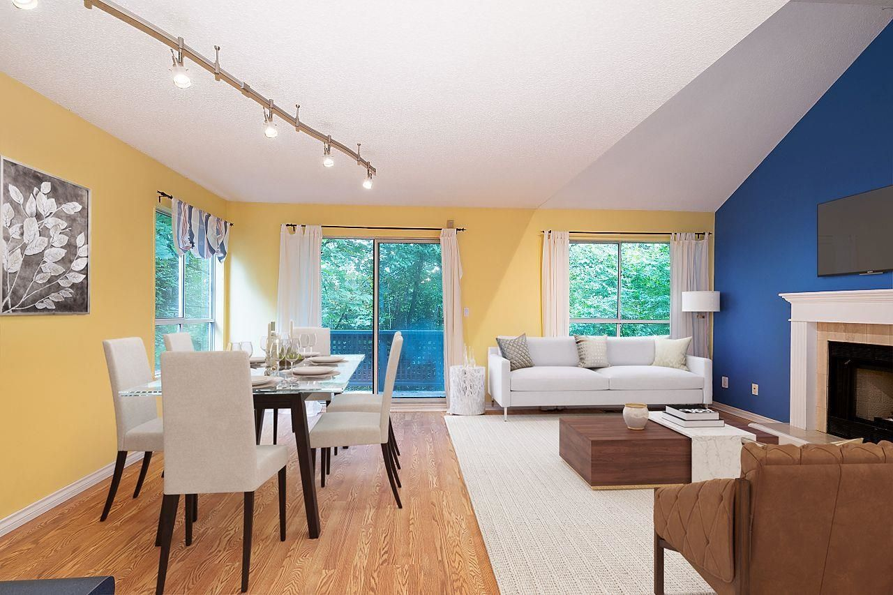 Staged to show options for furniture placement.  Note the Vaulted ceilings and big windows framing the surrounding trees.