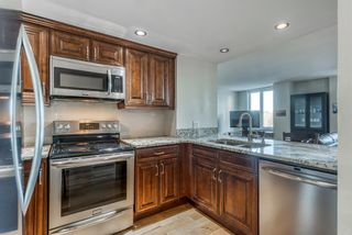 Photo 2: 450 310 8 Street SW in Calgary: Eau Claire Apartment for sale : MLS®# A1060648