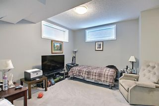 Photo 40: 566 River Heights Crescent: Cochrane Semi Detached for sale : MLS®# A1129968