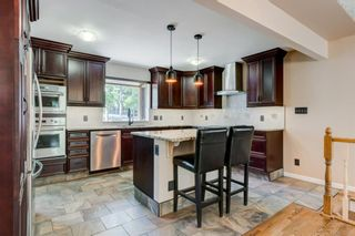 Photo 12: 6131 Lacombe Way SW in Calgary: Lakeview Detached for sale : MLS®# A1129548
