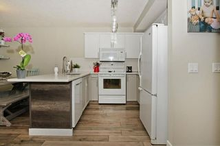 Photo 11: 212 MT APEX Green SE in Calgary: McKenzie Lake House for sale : MLS®# C4144299
