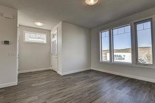 Photo 4: 136 Creekside Drive SW in Calgary: C-168 Semi Detached for sale : MLS®# A1108851