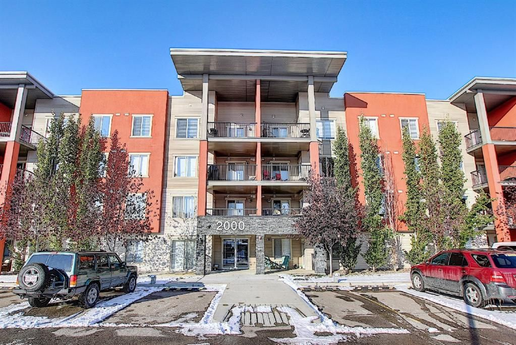 Main Photo: 2413 403 Mackenzie Way SW: Airdrie Apartment for sale : MLS®# A1052642