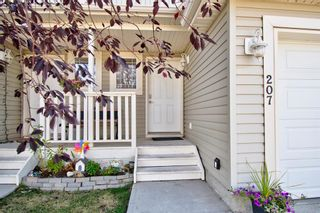 Photo 2: 207 BAYSIDE Point SW: Airdrie Row/Townhouse for sale : MLS®# A1035455