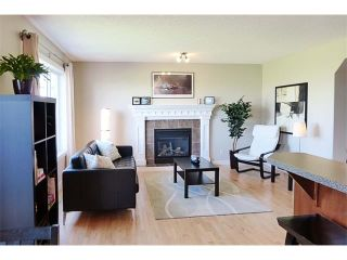 Photo 10: 772 LUXSTONE Landing SW: Airdrie House for sale : MLS®# C4016201