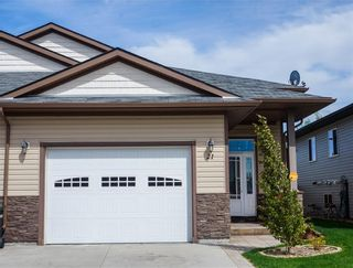 Photo 2: 21 Destiny Way: Olds Semi Detached for sale : MLS®# A1018668