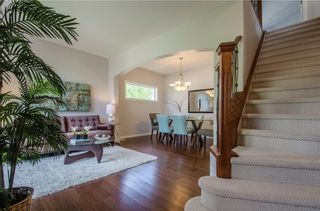 Photo 2: 26 STRATHLEA Crescent SW in Calgary: Strathcona Park House for sale : MLS®# C4139660