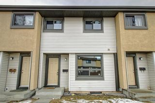 Photo 1: 104 2720 RUNDLESON Road NE in Calgary: Rundle Row/Townhouse for sale : MLS®# C4221687