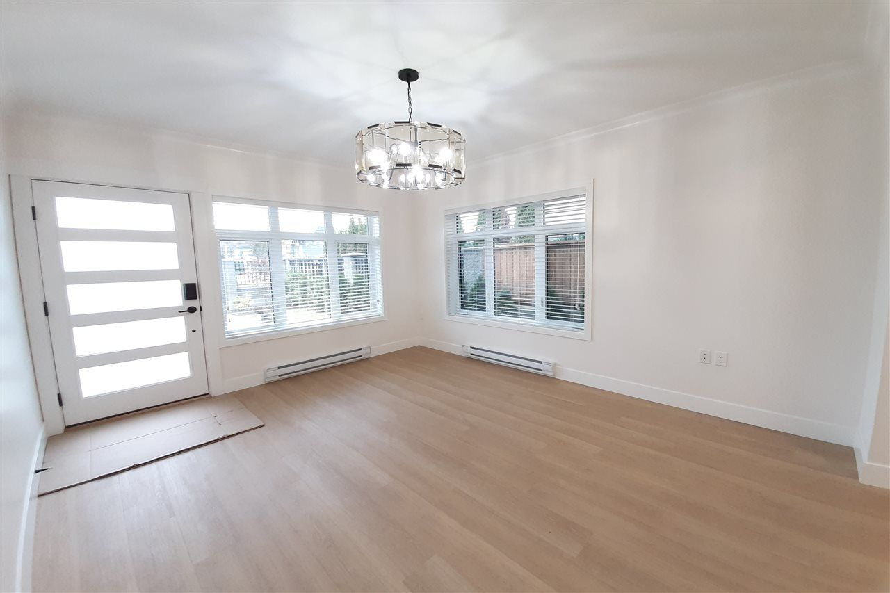 Photo 2: Photos: 8076 FRASER Street in Vancouver: South Vancouver 1/2 Duplex for sale (Vancouver East)  : MLS®# R2416831