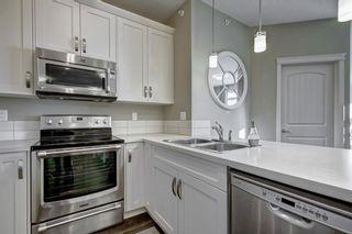 Photo 10: 1406 522 CRANFORD Drive SE in Calgary: Cranston Apartment for sale : MLS®# A1080413