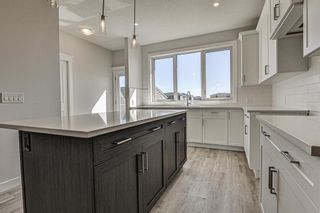 Photo 9: 132 Creekside Drive SW in Calgary: C-168 Semi Detached for sale : MLS®# A1098272