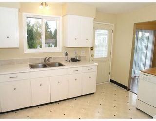Photo 4: 3632 FLINT Street in Port_Coquitlam: Glenwood PQ House for sale (Port Coquitlam)  : MLS®# V758871