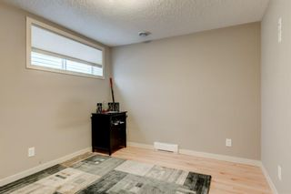 Photo 25: 175 Cougarstone Court SW in Calgary: Cougar Ridge Detached for sale : MLS®# A1130400