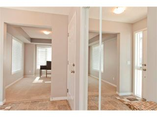 Photo 2: 100 WINDSTONE Mews SW: Airdrie House for sale : MLS®# C4055687