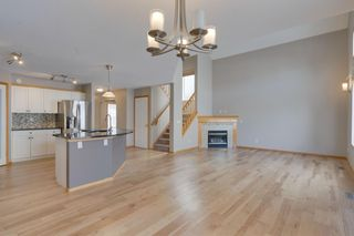 Photo 4: 106 Arbour Butte Road NW in Calgary: Arbour Lake Detached for sale : MLS®# A1075299