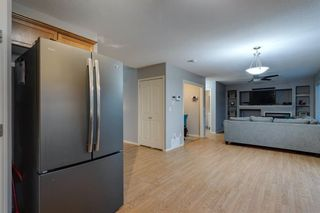 Photo 10: 704 Luxstone Square SW: Airdrie Detached for sale : MLS®# A1133096